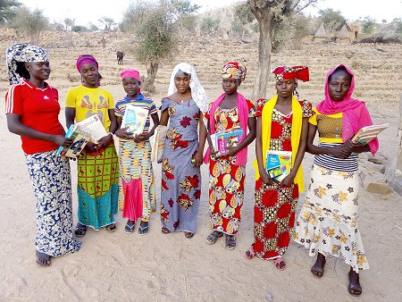 Girl Power! Proud scholarship holders with their school books. Photo: © AAFMHL