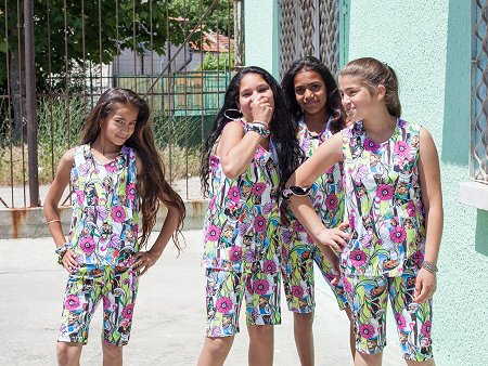 Girls in the project FLORIKA wearing dresses they themselves produced in their sewing classes. Photo: © TERRE DES FEMMES